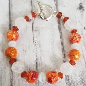 Orange and white glass bead bracelet